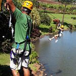 Zipping over the tropical plantation waterway